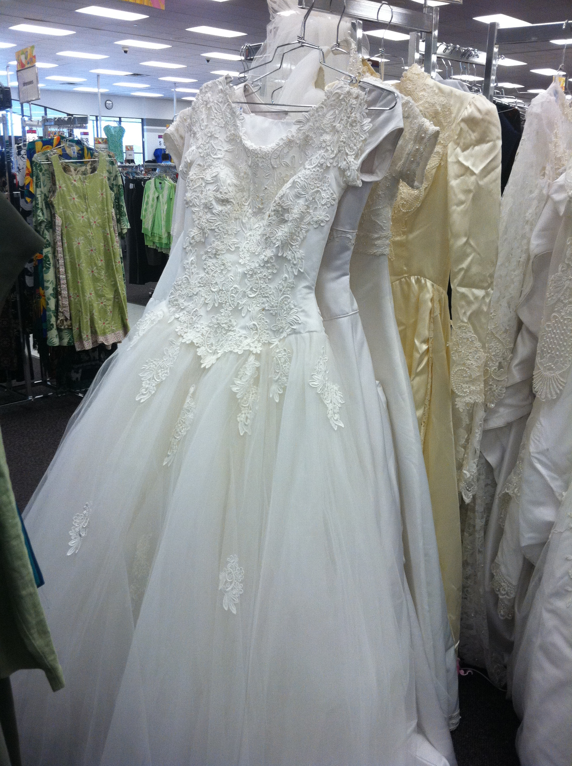 Shopping for a wedding dress don 39 t underestimate this store for Shop online wedding dresses